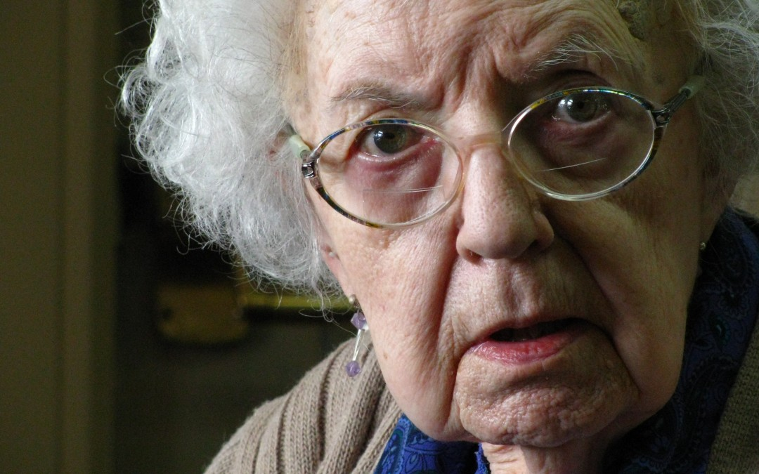 Photo of angry old woman glaring into camera